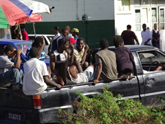 St Lucians crammed in the back of a truck in busy Castries
