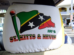 Flag of St Kitts & Nevis on the back of our taxi driver's headrest