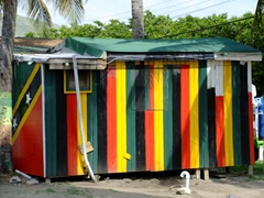 A very patriotic beach shack, adorned in the colors of the St Kitts & Nevis flag