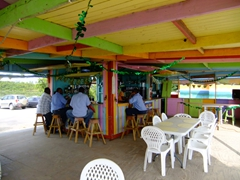 Locals sipping on beer at the rainbow colored bar; South Frigate Bay
