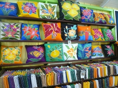 Colorful batik styled pillows for sale at a store in Basseterre