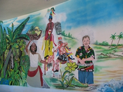 A colorful wall painting behind the St Kitts tourism desk; Port Zante