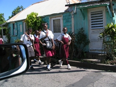 St Kitts school children wearing school uniforms take a break for lunch (we were told that the color of the uniform indicates which school the child attends)