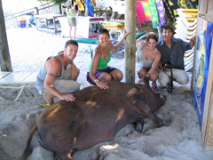 Robby, Becky, Shannon, and Luke pose beside Wilbert the obese pig