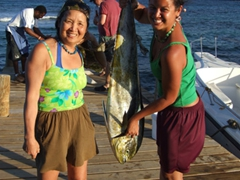 Becky struggles to hold onto this massive mahi mahi