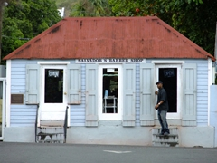 Local coming out of the Salvador's barber shop; Christiansted