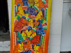 Colorful painting for sale; Christiansted's King Street shopping arcade