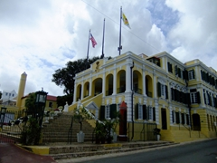 The Government House on King Street. This served as residence for Governors of the Danish West Indies and offices of the colonial government. The Baroque central wing was built in 1747 as a private residence