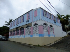 Pastel colored building typical of Christiansted, one of the prettiest Caribbean villages we visited