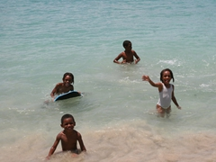 Friendly local kids beckoning us to join them for a quick swim