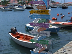 Colorful sign post; Gustavia Harbor