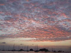 A glorious pink sky over Gustavia's anchored yachts rewards us at the end of another day in paradise