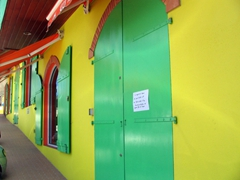 A colorful boutique closes during lunchtime; Gustavia