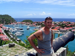 Robby poses at Fort Gustave, with Gustavia Harbor in the background