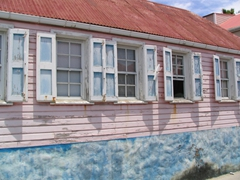 This pretty pink n' blue cottage in Gustavia could use a fresh coat of paint