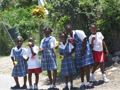Nevian school kids on their lunch break strike a pose to proudly display their uniforms