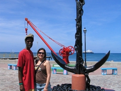 A Rastafarian musician strikes a pose with Franny after unsuccessfully convincing her to buy his CD; Charleston Harbor