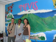 Robby & Franny posing next to a member of the super friendly Nevis Tourist Info Office staff