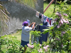 A Nevian woman hanging her clothes out to dry