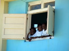School kids peer out their window during a short recess