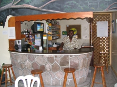 Lex proudly poses by his bar at the Hill Top Bar & Restaurant