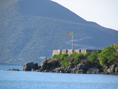 The Nevis flag blows proudly across the harbor at Oualie's Beach resort
