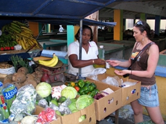 Franny buys some bananas and papayas to satiate our hunger at the Charlestown fruit market