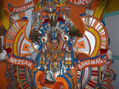 Laverne posing behind one of the most photographed Junkanoo costumes of all time