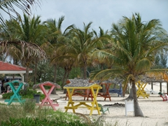 Colorful beach tables; Taino Beach Resort