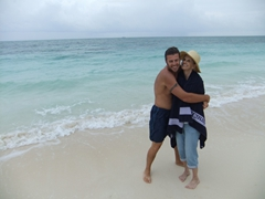 A wet Robby hugs a dry Laverne tight after his chilly swim in the sea