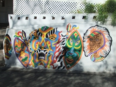 Junkanoo face masks painted on the wall; Nassau