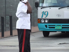 Cop directing traffic; Nassau