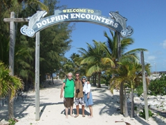 A family portrait beneath the Dolphin Encounter sign