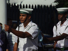 Close up of two marching Bahamian sailors; Nassau