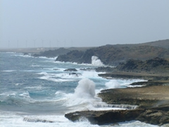 Tumultuous waves crashing against the rugged coastline near the Natural Pool