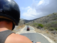 Robby following closely behind Michael on the surprisingly good roads of Arikok National Park