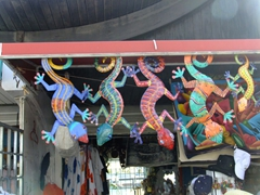 Colorful geckos line the streets in Oranjestad