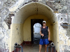 Robby stands between two old cannons at the exit to Ft George