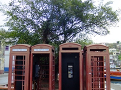 Now defunct British style telephone booths; Carenage Harbor