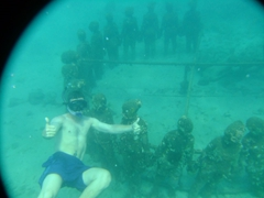 "Robby posing next to ""Vicissitudes"", 26 figurines at a depth of 4.5 meters; Underwater Sculpture Park in Grenada"