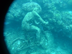 "Man on a bike entitled ""The Fall from Grace""; Underwater sculpture park"