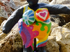Colorful figurine at the cruise ship pier; Willemstad