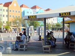 Taxi drivers patiently wait to be needed; Willemstad