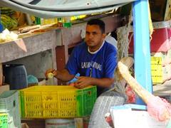 Venezuelan peeling vegetables; floating market