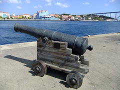Old cannon pointing towards Otrobanda