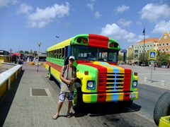 Robby stands next to a colorful bus on the Otrobanda district of Willemstad