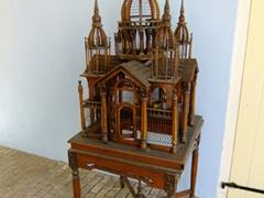 Intricate wooden bird cage; Kura Hulanda Complex
