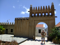 Robby stands in the courtyard of the Kurá Hulanda Museum