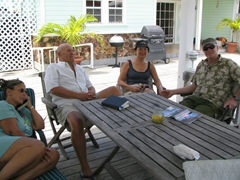Judy, Joe, Ann & Bob relaxing on the veranda; Jolly Beach Harbor