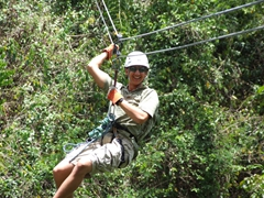Luke enjoying the ride on the zip line